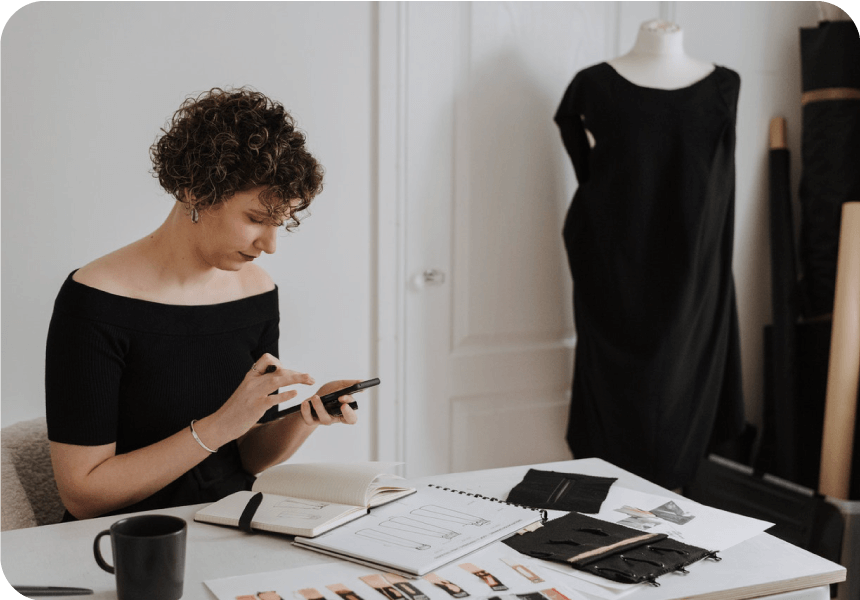 fashion business owner texts with customer