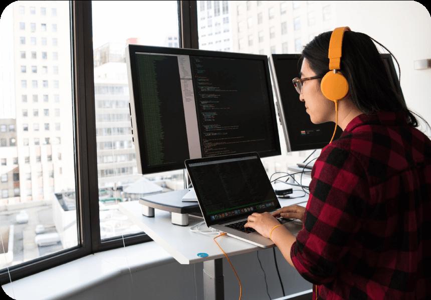 woman uses computer to code sms api